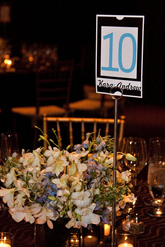 wedding reception black white blue table number centerpiece