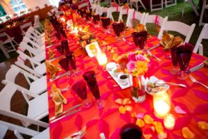 Indian fusion wedding fuchsia orange tablescape head table