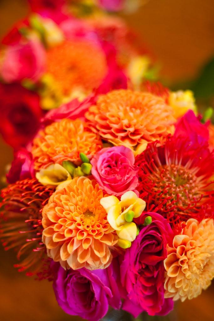 orange-fuchsia-wedding-bouquets-dahlias-pin-cushions