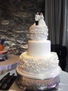 white fondant round wedding cake ruffles lulu cake boutique