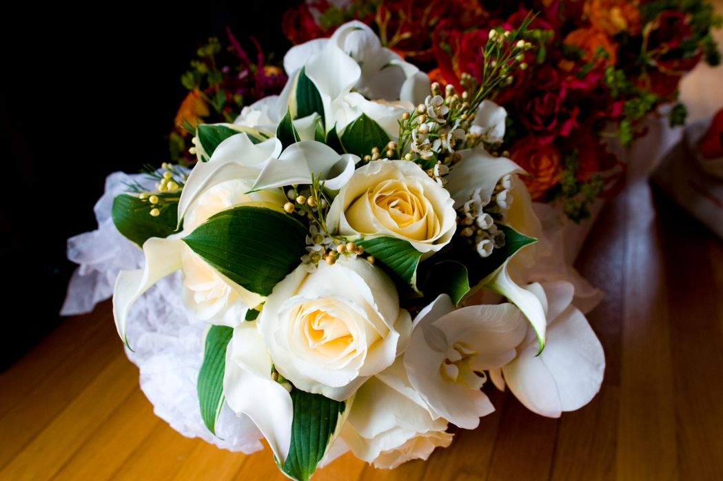 white bridal bouquet Urban Petals roses hosta wax flowers