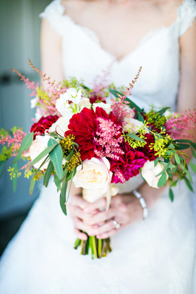 bridal-bouquet-pink-rose-burgundy-dahlia-celosia-ivory-stock-astilbe-petals-edge