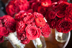 red bridesmaids bouquets