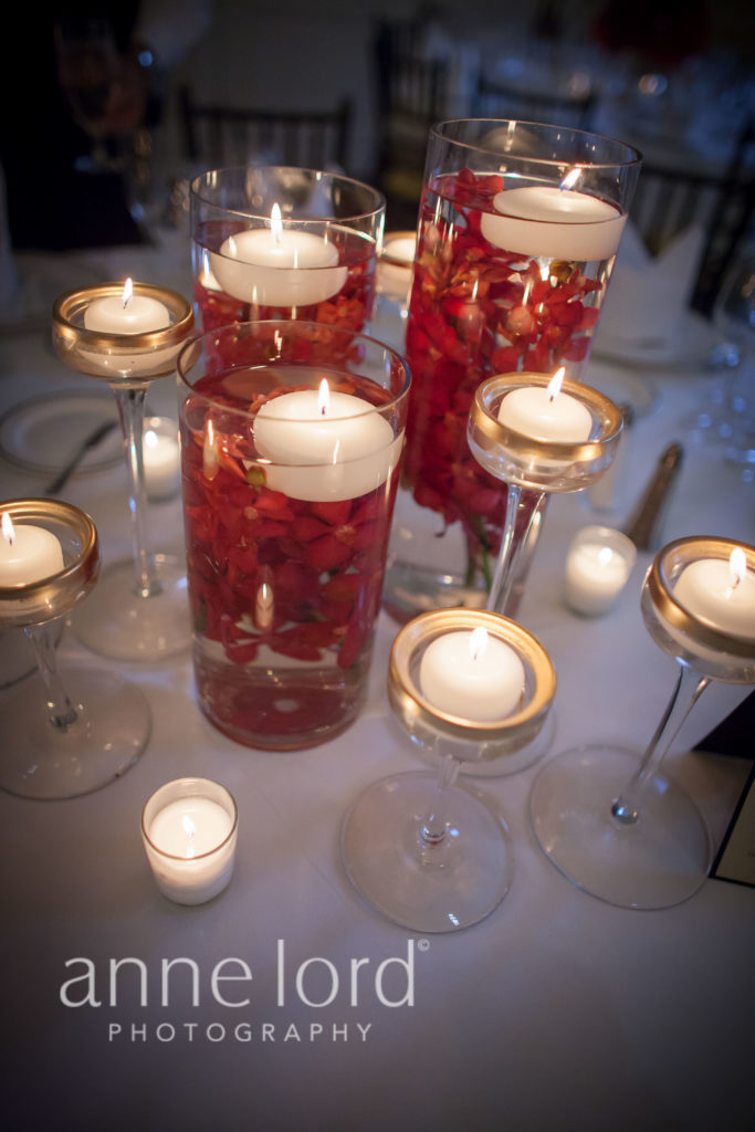 red orchids submerged floral centerpiece floating candles
