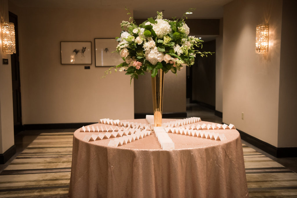 escort_card_table_tall_floral_arrangement_pink_white_green